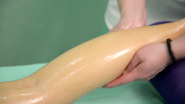legs and buttocks massage - massager stock videos and b-roll footage