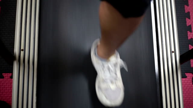 legs and feet of a man who was jogging on a treadmill. - treadmill stock videos & royalty-free footage