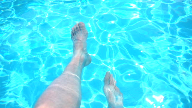 Legs in swimming pool
