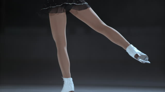slo mo td legs of a female figure skater during a spin - figure skating stock videos & royalty-free footage