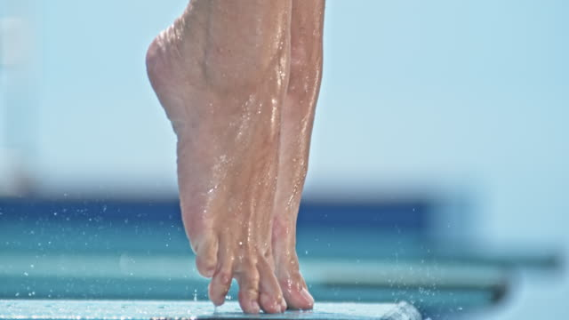 slo mo legs of a female high diver jumping off the diving board - jumping stock videos & royalty-free footage