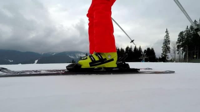 legs of a skier with skis during skiing close-up. - ski pole stock videos & royalty-free footage