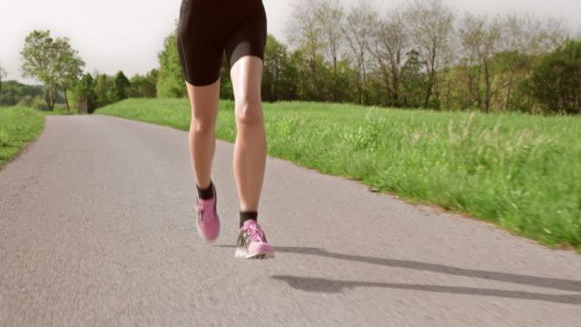 slo mo ts legs of a woman running - human limb stock videos & royalty-free footage