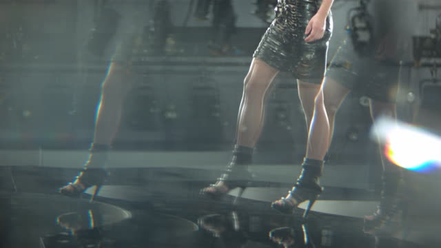 legs of a woman wearing a black dress and high heels while on a catwalk. - fashion stock videos & royalty-free footage