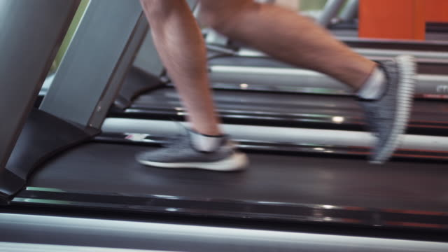 legs of athlete running on treadmill at the gym - treadmill stock videos and b-roll footage