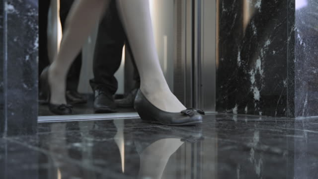 ld legs of business people as they exit the elevator - getting out stock videos & royalty-free footage
