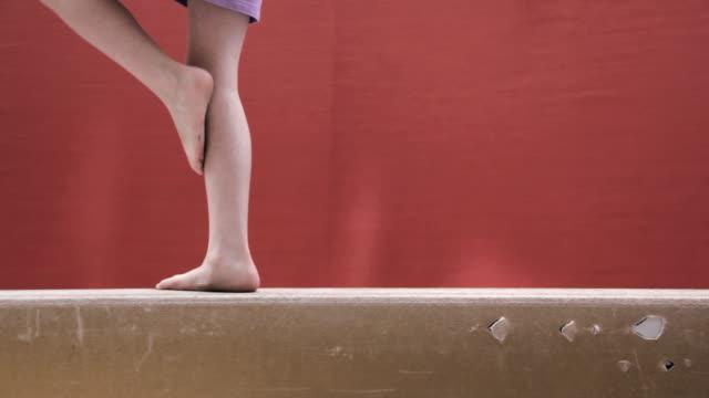 CU Legs of children walking on balance beam / Vancouver, British Columbia, Canada