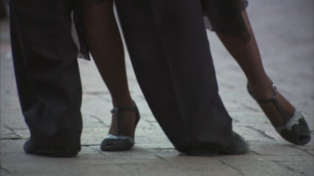 MS PAN Legs of couple dancing in plaza / Bogota, Colombia