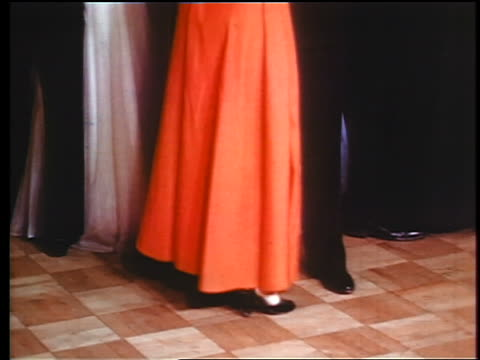 1945 fade in legs of couples in formalwear dancing / industrial - fade in stock videos & royalty-free footage