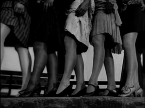 B/W 1921 PAN legs of flappers in short dresses / documentary