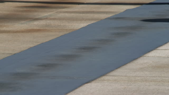 Legs of guard pacing toward the camera at Tomb of the Unknowns in Arlington National Cemetery. Shot in May 2012.