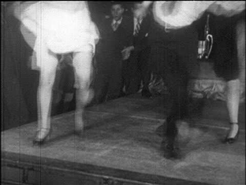 stockvideo's en b-roll-footage met b/w 1925 legs of people dancing charleston at dance marathon / roseland ballroom, nyc / newsreel - 1925