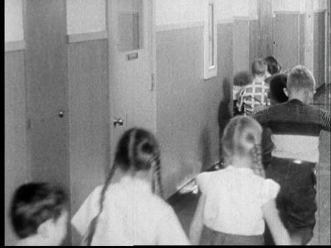 cu legs of school children walking through hall/ ws children lining up along wall in hallway and doing 'duck and cover' drill/ ms children crouching - drill stock videos & royalty-free footage