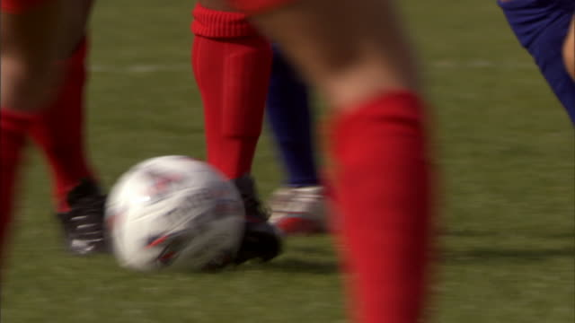 ms legs of two soccer teams kicking ball around field during game/ sheffield, england - human leg stock videos & royalty-free footage