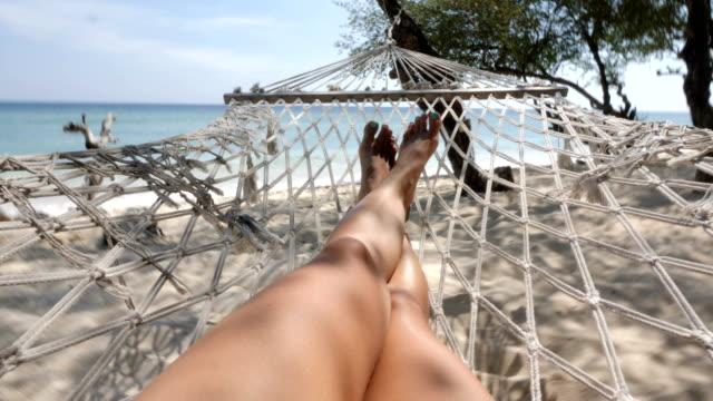 legs of woman in bikini on a hammock at the beach in gili trawangan island in bali - hammock stock videos & royalty-free footage