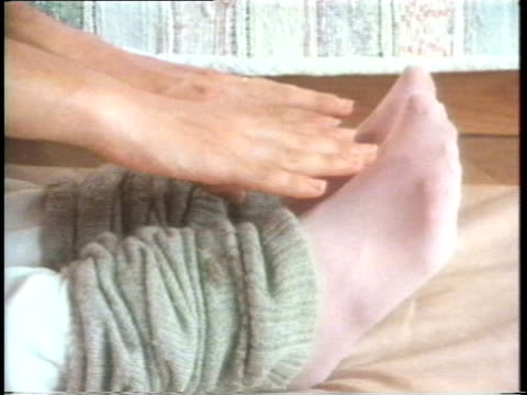 1985 cu legs of woman in leg warmers as she touches her toes - leg warmers stock videos & royalty-free footage