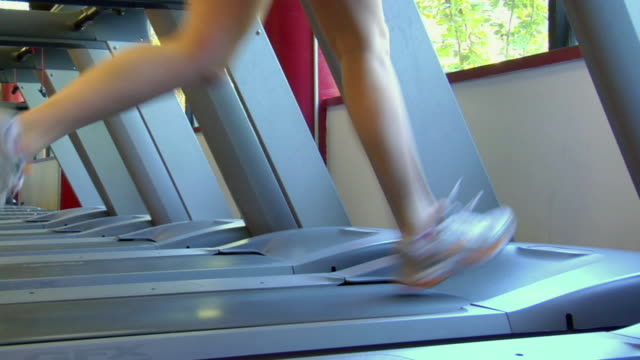 MS Legs of woman running on treadmill in fitness club/ San Antonio, Texas