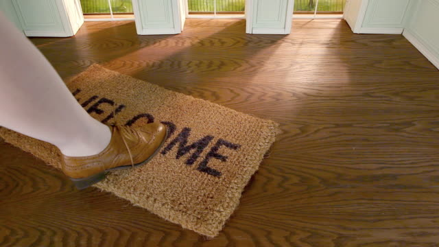 legs of woman stepping on welcome mat - welcome mat stock videos and b-roll footage
