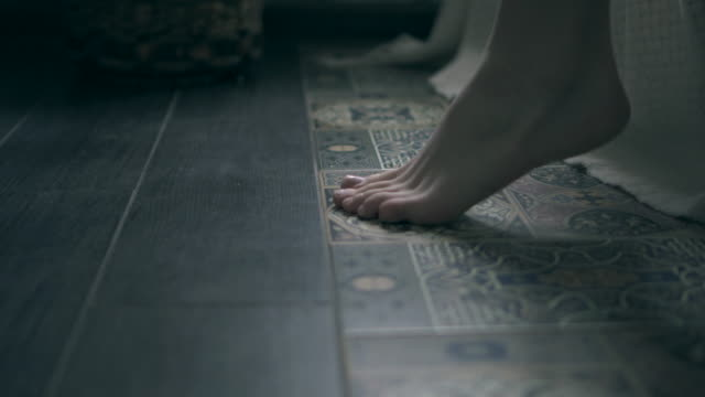 Legs of woman touching floor in the morning after getting out bed