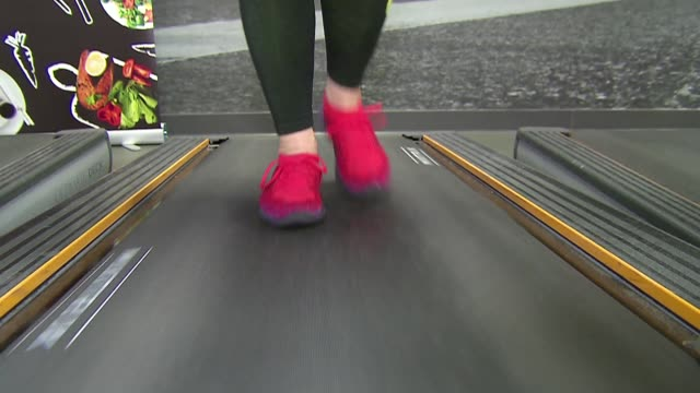 legs on treadmill in fitness club - exercise machine stock videos & royalty-free footage