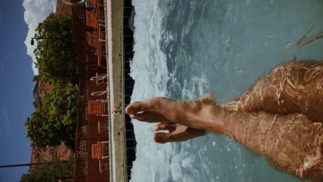 legs relaxing point of view: in a hot tube pool - sunbathing stock videos & royalty-free footage