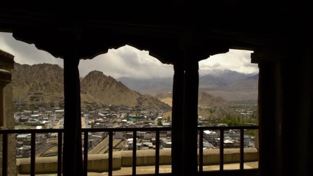 leh city between silhouette pillars, leh ladakh - ベランダ点の映像素材/bロール