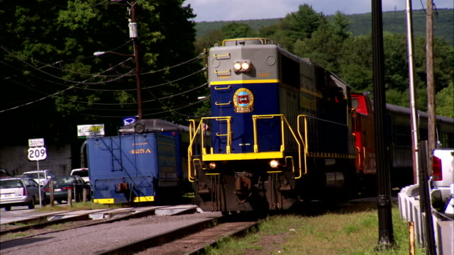 WS Lehigh Gorge Scenic Railway locomotive train passing by on railroad through frame pulling into Switch Back Gravity Railroad Carbon County PA old...