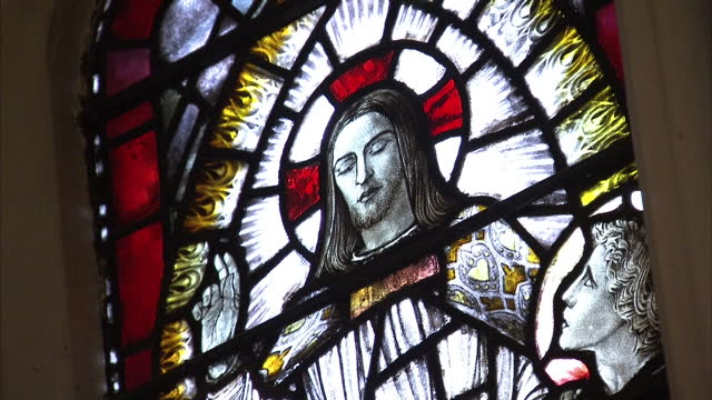 leicester cathedral interiors showing church pews, alter and stained glass windows showing depictions of jesus christand his apostles. leicester... - anglican stock videos & royalty-free footage