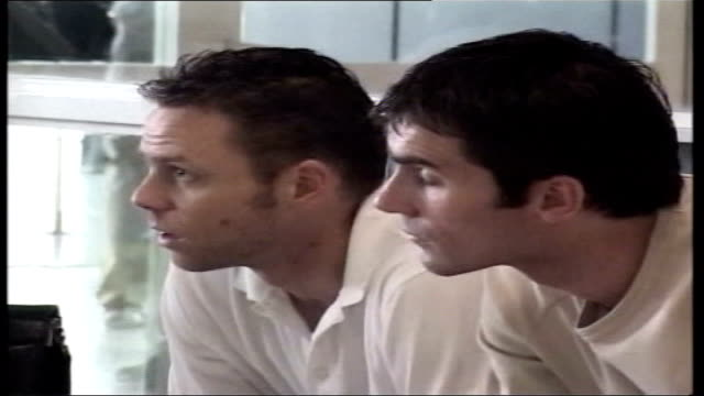 forensic tests prove negative lib keith gillespie frank sinclair and paul dickov waiting in airport lounge - sinclair institute stock videos and b-roll footage