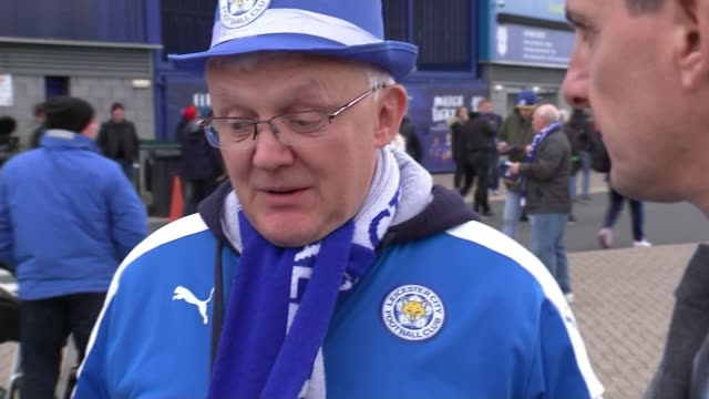 minute's silence held before leicester city v cardiff city match uk wales cardiff leicester city fans posing outside cardiff city stadium people... - itv weekend evening news stock-videos und b-roll-filmmaterial