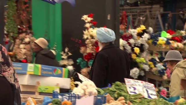 reactions / how did they do it england leicester int leicester city fc flag hung over market stall woman wearing face veil at fruit and veg stall... - leicester stock videos & royalty-free footage