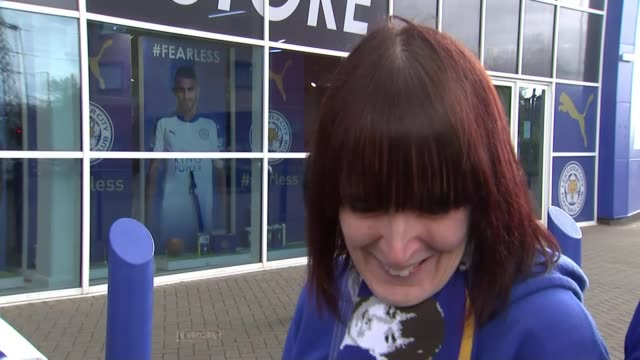 leicester city win premier league title: reactions / how did they do it?; dog wearing leicester city shirt vox pops sot various of leicester city... - autographing stock videos & royalty-free footage