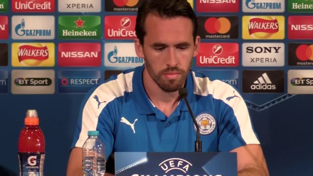 Leicester manager Craig Shakespeare and defender Christian Fuchs discuss the second leg of their Champions League quarter final match with Atletico...