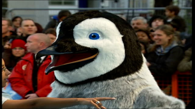 leicester square premier of 'happy feet' england london leicester square ext person wearing penguin costume dancing low angle shot of legs of person... - flightless bird stock videos & royalty-free footage