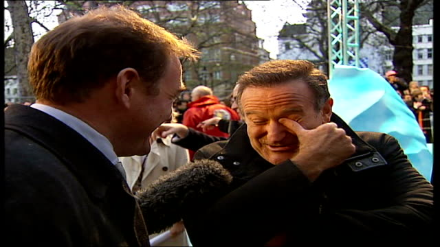leicester square premier of 'happy feet' robin williams interview sot feels kind of strange / sean what do you think / i don't understand how you did... - robin williams actor stock videos & royalty-free footage