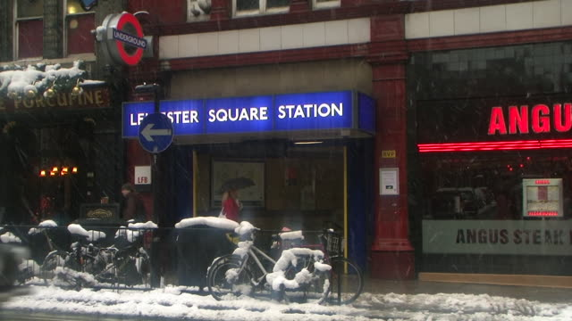 MS Leicester Square Station entrance and street covered with snow, London, United Kingdom