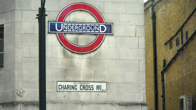 cu leicester square station entrance in london - leicester square stock videos & royalty-free footage