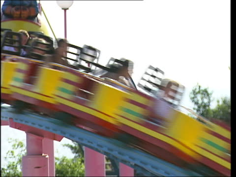 leigh-on-sea and southend-on-sea seaside general views; good shots of adventure island fairground on sea front, tourists on rollercoaster, candy... - fairground stall stock videos & royalty-free footage