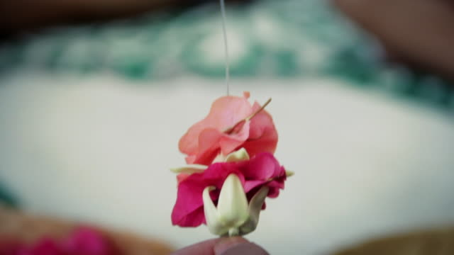 Lei-making at a resort on Kauai, Hawaii