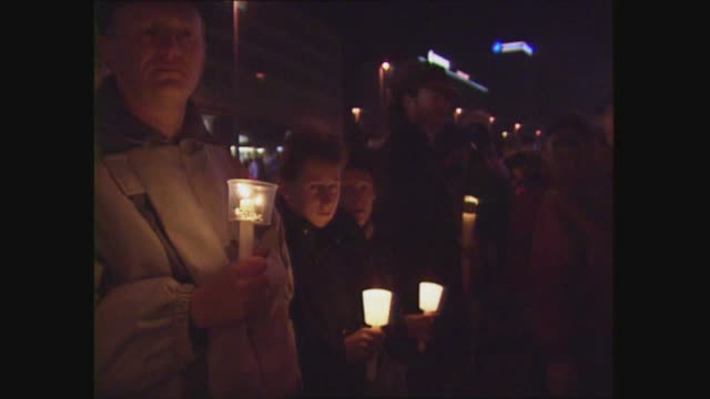 leipzig ts demonstrators holding banners ms demos holding candles demos walking along carrying banners holding candles ts mass crowds along holding... - 1989 stock-videos und b-roll-filmmaterial