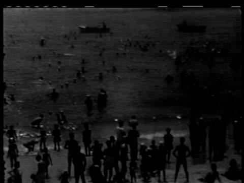 leisure activities at jones beach on july 05 1949 in new york new york - 1949 stock-videos und b-roll-filmmaterial