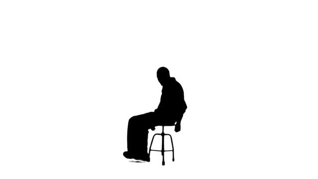 vídeos de stock e filmes b-roll de lazer-rotação em uma cadeira - silhueta