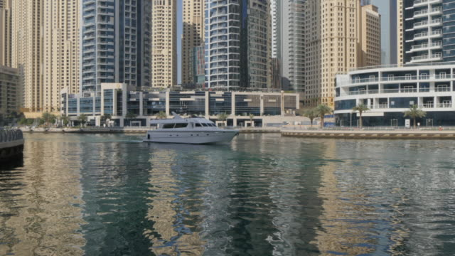 Leisure boat sailing into Dubai Marina, Dubai, United Arab Emirates, Middle East, Asia
