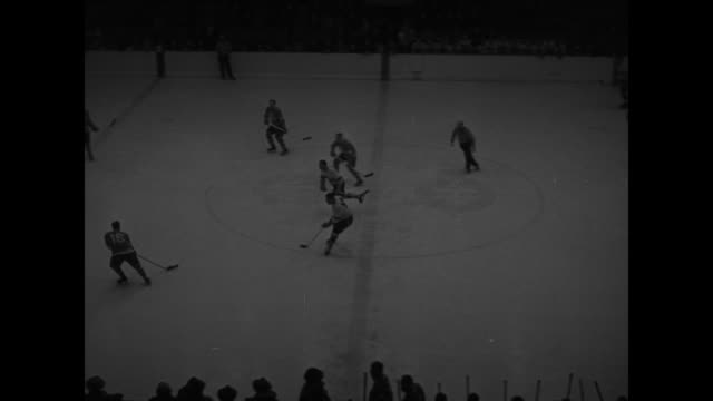 leisurely players on rink / high angle view of circle of hockey players and others on ice with flash of camera / players pose with sticks at ready as... - injured stock videos & royalty-free footage