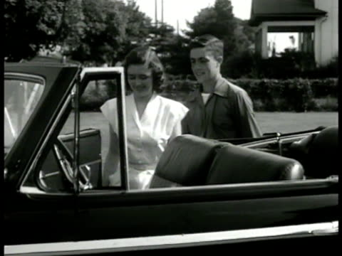 'leland walker' dating ws 'leland walker' walking w/ girlfriend 'mona' to black convertible car houses bg ms leland opening door for mona ms leland... - regole dell'etichetta video stock e b–roll