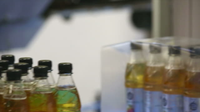 lemon bottle shrink packaging close-up - polyethylene terephthalate stock videos and b-roll footage