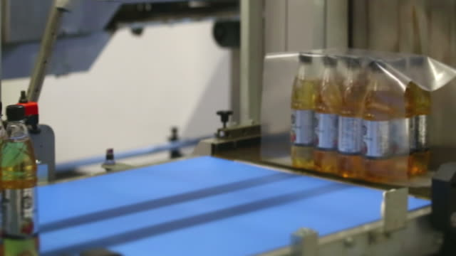 lemon bottle shrink packaging - polyethylene terephthalate stock videos and b-roll footage