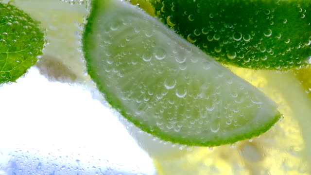 lemon drop in fizzy sparkling water, juice refreshment - citrus fruit stock videos and b-roll footage