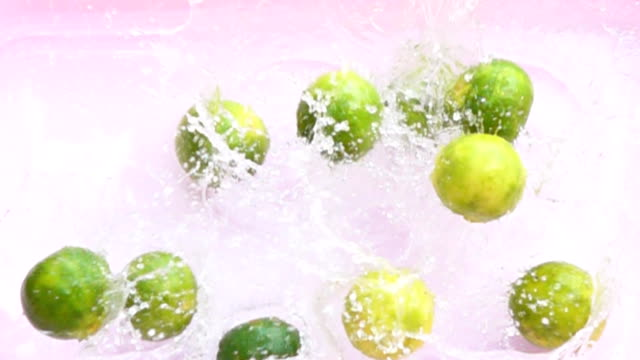 lemon drop on water,slow motion - cachaça stock videos & royalty-free footage