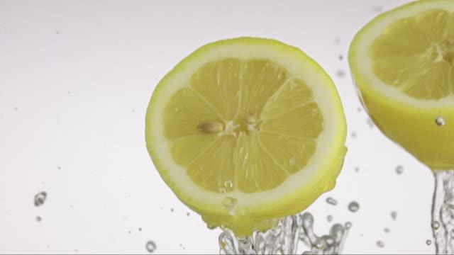 lemon flying and creating splashing droplets